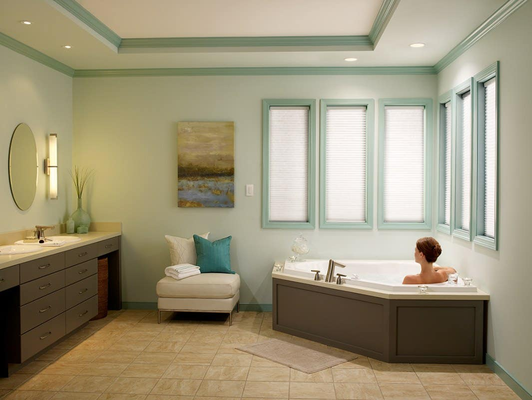 Woman in Tub with Fully Closed Light Filtering Honeycomb Shades