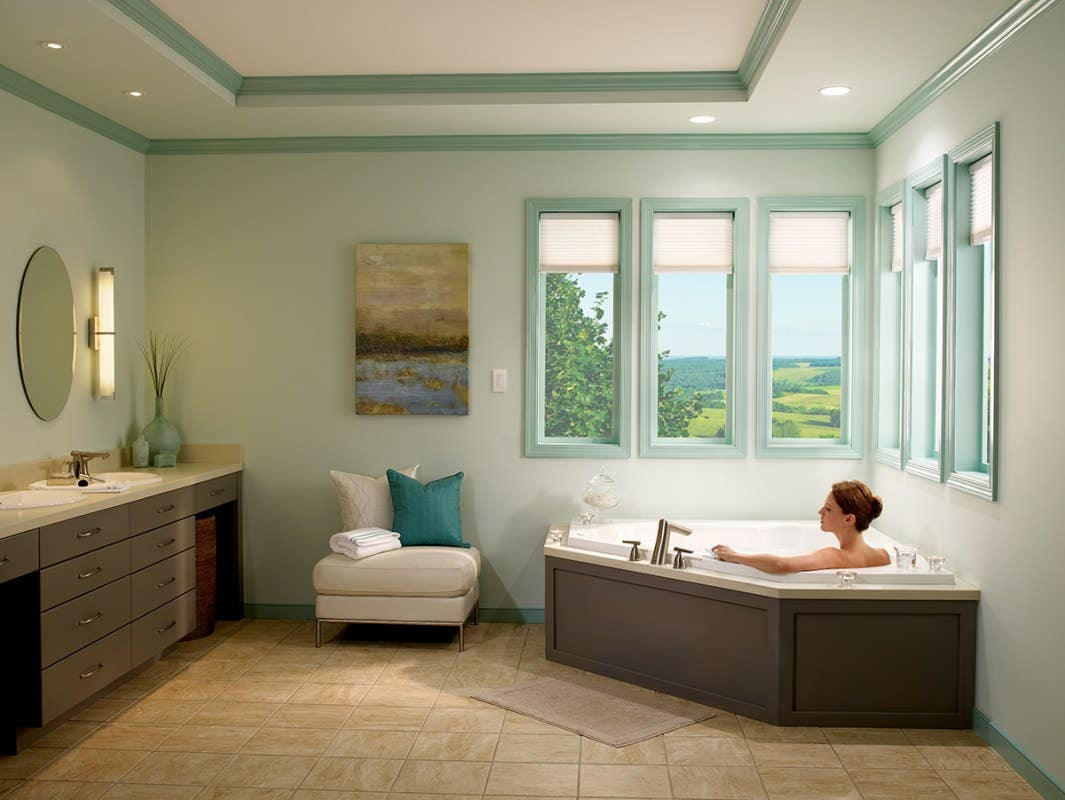 Woman in Tub with Partially Closed Light Filtering Honeycomb Shades